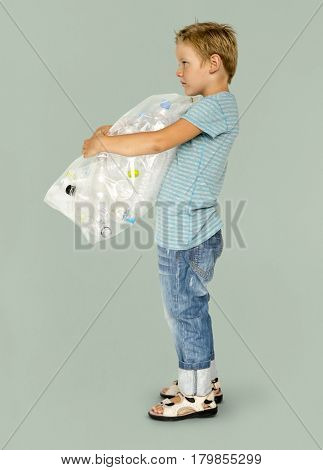 Ecology little boy holding bag of plastic bottle for recycle