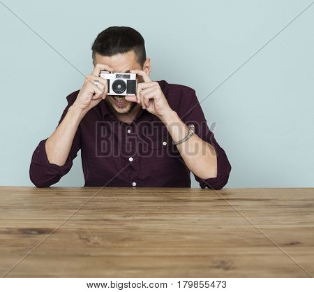 A man taking a photo by film camera