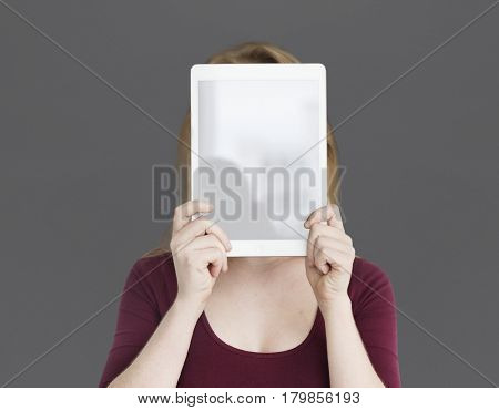 Woman Holding Up Tablet Covering Face