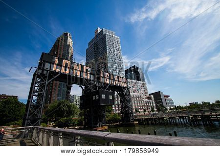 iconic gantries of Gantry State Park and fence with cloudy sky