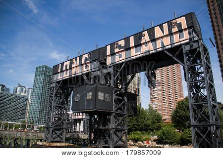 Long Island sign at Gantry Plaza State Park with blue sky, New York