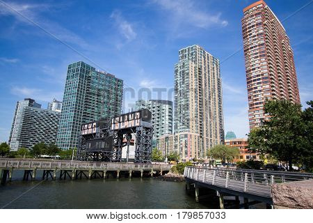 Pier at Gantry Plaza State Park and buildings with blue sky, New York
