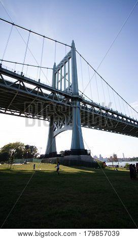 Triborough bridge and the shade with blue sky, Astoria Park, New York