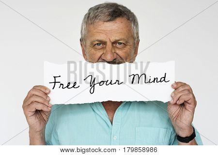 Studio shoot person holding paper with aspiration message