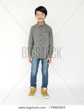 Young boy standing and posing for photoshoot