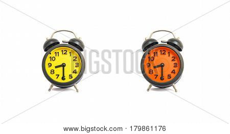 Closeup yellow alarm clock and orange alarm clock for decorate show a half past eight o'clock or 8:30 a.m. isolated on white background