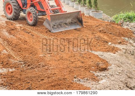 Closeup surface land reclamation by backhoe car is working