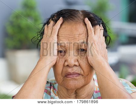 Senior Woman With Worried Stressed Face