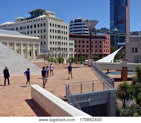 Wellington New Zealand - November 18 2016: Wellington downtown CBD Architecture including new buildings wlakways and pedestrians walking at lunchtime.