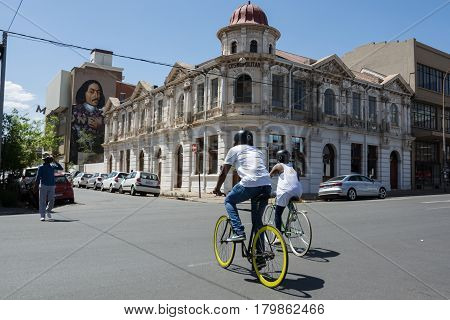 Couple Cycling Through The Maboneng Precinct Of Johannesburg