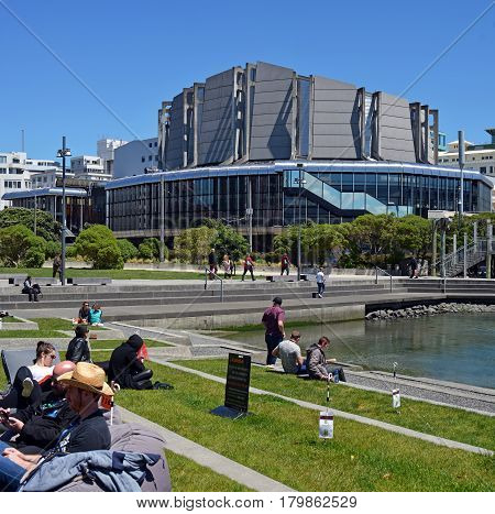Wellington New Zealand - November 18 2016: Wellington people and visitors enjoying Spring sunshine at lunchtime on the grass outside the Town Hall building.