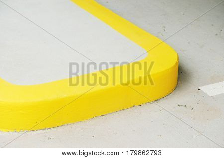 close up on yellow curb of sidewalk