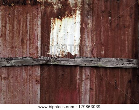 Old rusty corrugated sheets with patinated paint. Photographed outdoors on an abandoned house in the Antilles. Natural light. Guadeloupe, French West Indies.