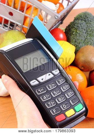 Payment Terminal With Credit Card And Fruits And Vegetables, Cashless Paying For Shopping