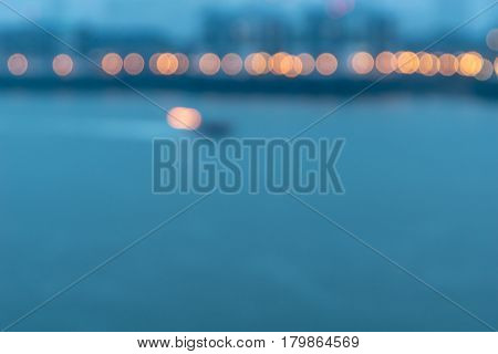 Abstract lights in top third of image across River Thames London UK from Wapping Wall.side.