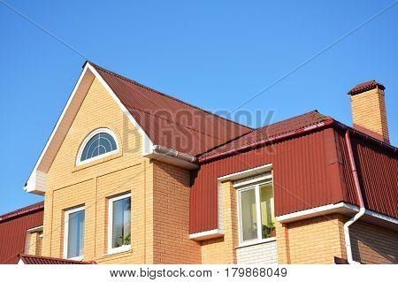 Attic construction outdoor. Attic Mansard house construction.