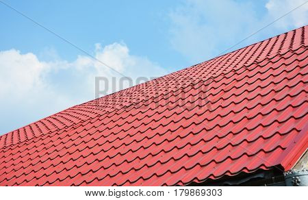 Red metal roof tiles. Metal Roof Shingles - Roofing Construction Roofing Repair.