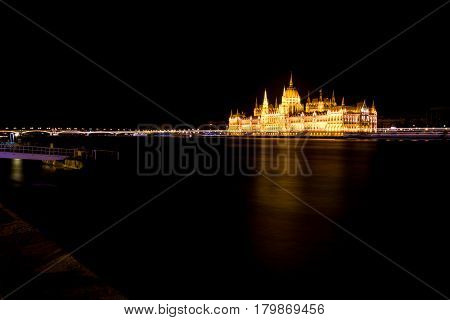 Hungarian Parliament And River Danube At Night