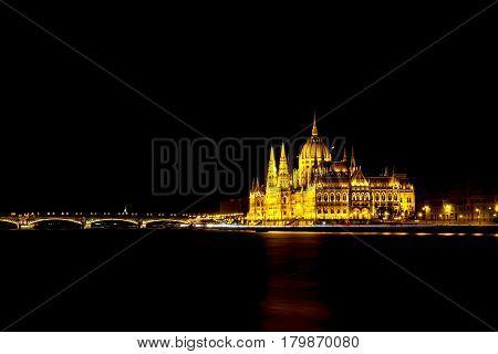 Hungarian Parliament Building And Bridge At Night