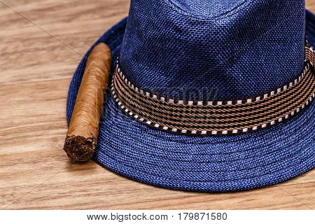 Blue Hat And Cigar On Wooden Floor, Smoke Concept