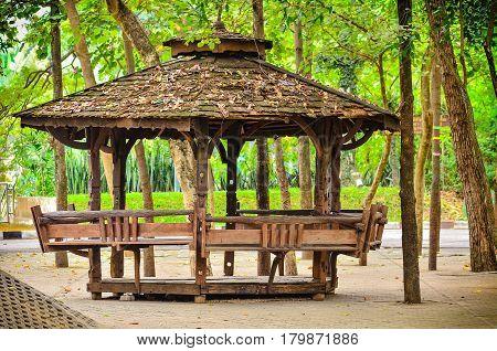Wooden Garden Gazebo in public park on light morning
