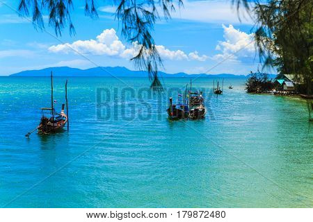 The fishing boats and blue sky in the calm sea.