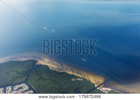 Group of yacht sailing on the open sea. Typical landscape on the west coast of Florida in Fort Myers. Aerial view of the sea and the beautiful beaches of Florida.