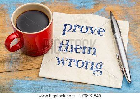 Prove them wrong  - handwriting on a napkin with a cup of coffee