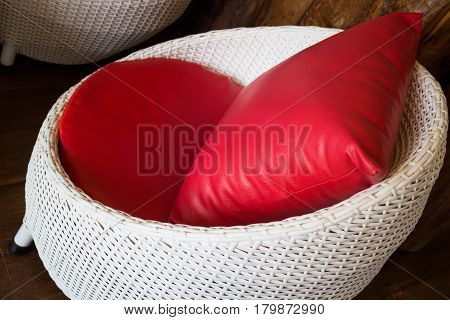 Red Pillow With Plastic Rattan Furniture stock photo