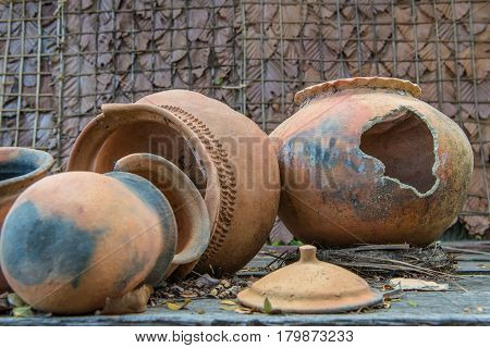 Broken Antique Clay Pot Or Traditional Jar On Abandoned Hut