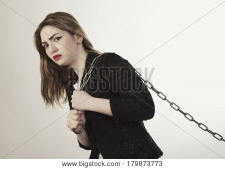 Young woman holding metal chain isolated photo