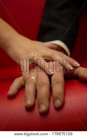Bridal concept - Hands of man and woman with wedding ring, close up