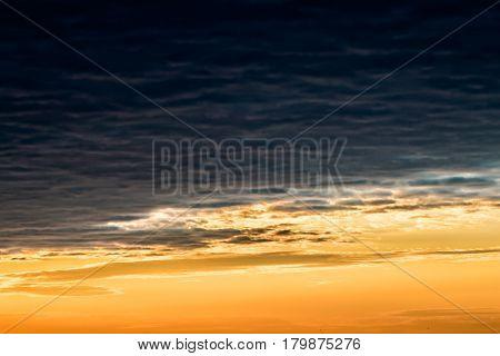 A huge dark cloud veiled celestial expanse at dawn