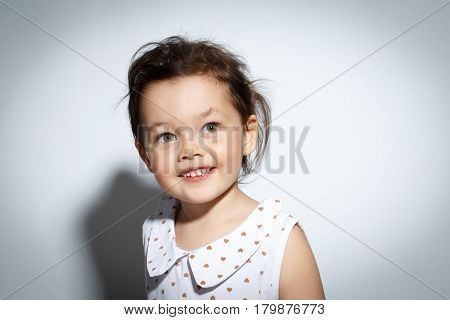 Close-up Portrait of 3 year old little girl with dress, Smiling on bright white background