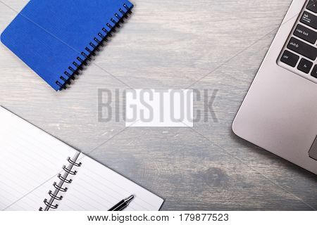Blank business card design mockup. Visiting card and laptop. Business branding template.