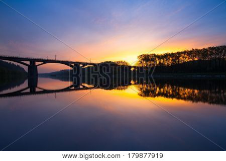 Branik bridge at sunrise. This bridge widely known as Bridge of intelligence is a rail and pedestrian bridge spanning the Vltava river in Prague.