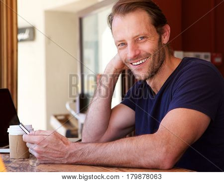 Attractive Man Smiling With Mobile Phone