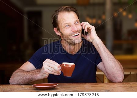 Handsome Older Man Holding Coffee Cup And Cellphone