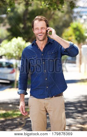 Handsome Man Standing Outside Talking On Cell Phone