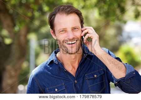 Close Up Cool Guy Laughing With Cell Phone
