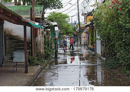 TORTUGUERO VILLAGE, COSTA RICA-MARCH 21, 2017: Road in tortuguero village at rainy weather, Costa Rica
