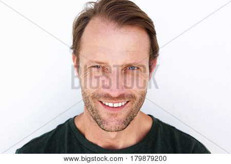 Smiling Man With Stubble Against White Background