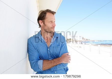 Male Fashion Model Leaning Against Wall Outdoors