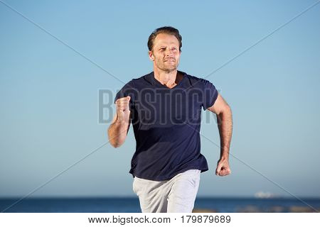 Fitness Man Running  Outdoors By The Sea