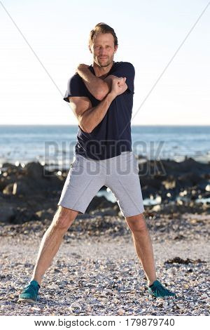 Full Body Fitness Man Stretching Outside