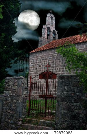 Gothic Chapel Graveyard on Full Moon Dramatic Sky Backgound