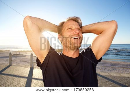 Handsome Fitness Man Laughing With Hands Behind Head