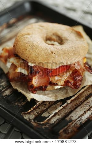 Food. Delicious bagel sandwich with bacon