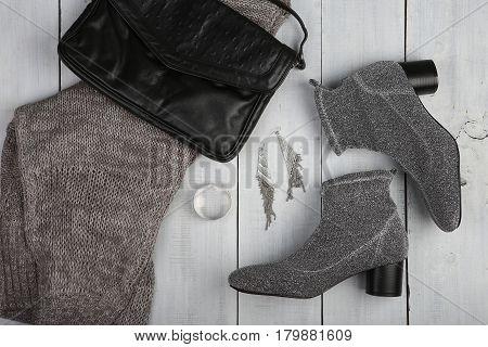 Set Of Woman Stuff On White Wooden Desk: Dress, Shoe, Bag, Accessories