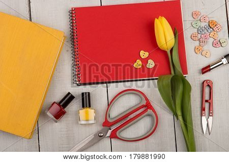 Flower Tulip, Blank Red Note Pad, Yellow Book, Scissors, Nail Polish And Buttons In The Shape Of Hea